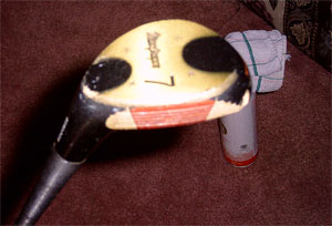 my trusty, if not considerably fucked up, 7-wood